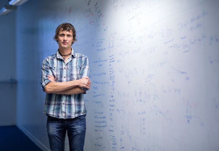 Professor Rudolph standing in front of a whiteboard