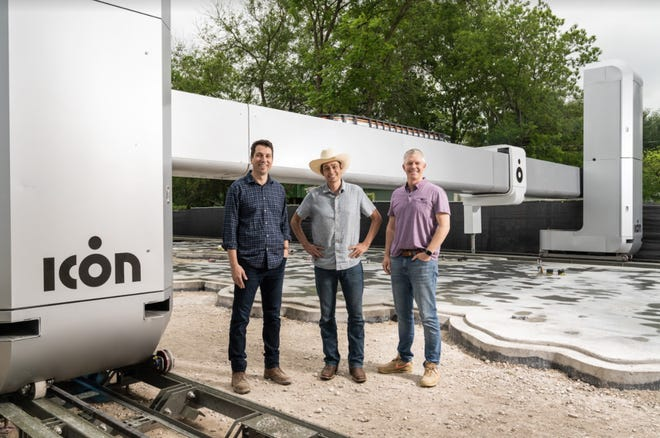 Austin-based 3D printing construction company Icon has raised $207 million as it continues its rapid growth.  Founders Alex Le Roux, Jason Ballard and Evan Loomis stand with the company's newest generation of printer, which is capable of 3D printing homes and structures of up to 3,000 square feet.